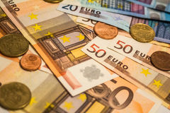 A composition of euro banknotes and coins Stock Photo