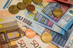 A composition of euro banknotes and coins Royalty Free Stock Image