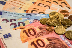 A composition of euro banknotes and coins Royalty Free Stock Photo