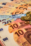 A composition of euro banknotes and coins Royalty Free Stock Images