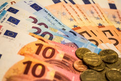 A composition of euro banknotes and coins Stock Image
