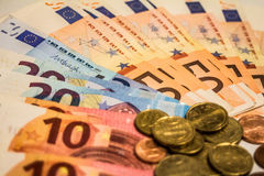 A composition of euro banknotes and coins Royalty Free Stock Photography