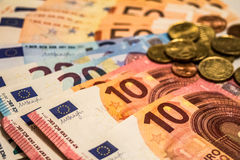 A composition of euro banknotes and coins Stock Images