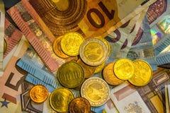 A composition of euro banknotes and coins Stock Photos