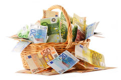 Composition with Euro banknotes in wicker basket Stock Image