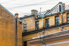 Composition of facades of apartment buildings. Composition of pieces of three different facades of apartment buildings with a lot of wires Stock Images