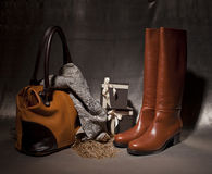 Composition Female boots decoreted with atumn acsessuares. Female boots decoreted with atumn acsessuares and gift boxes Stock Photo