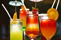 Composition with five glasses of drinks Stock Images