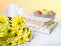 Composition with flowers and books. Composition with morning flowers and books royalty free stock image