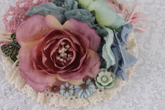 Composition with flowers from fabric. Delicate flower compositions from flowers from a fabric Royalty Free Stock Photo
