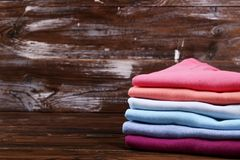 Composition with folded clothes, unisex for both man and woman, different color & material. Pile of laundry, dry clean clothing. Stack of colorful perfectly royalty free stock images