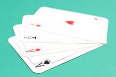 Composition of four aces on green background Royalty Free Stock Photography