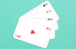 Composition of four aces on green background Royalty Free Stock Photos