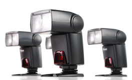 Composition with four camera flashes isolated. On white Royalty Free Stock Photo