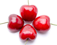 Composition with four cherries Stock Images
