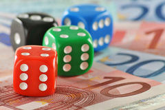 Composition with four dices and euro banknotes Royalty Free Stock Photo