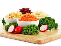Composition with four vegetable salad bowls Royalty Free Stock Image