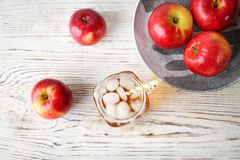 Composition with fresh apple juice on wooden table. Top view Stock Images