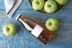 Composition with fresh apple juice on wooden table,. Top view Stock Photos