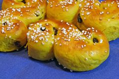 Composition of fresh baked of Saffron Buns with Raisins and sugar-sprinkled. For traditional Swedish Christmas Party - Saint Lucia Stock Photos