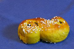 Composition of fresh baked of Saffron Buns with Raisins and sugar-sprinkled. For traditional Swedish Christmas Party - Saint Lucia Stock Image