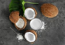 Composition with fresh coconut water. On dark background Stock Image