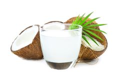 Composition with fresh coconut water. On white background Stock Photos