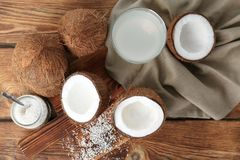 Composition with fresh coconut water. On wooden background Stock Photos