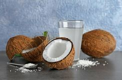 Composition with fresh coconut water. On dark table Stock Image