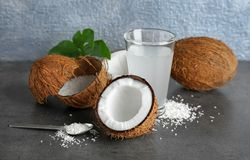 Composition with fresh coconut water. On dark table Royalty Free Stock Photo