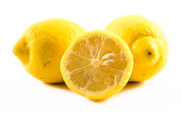 Composition of fresh and cut lemons on a white background Stock Photo