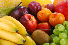 Composition with fresh fruits. Composition with fresh wet fruits with visible drops of water Stock Photos