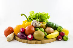 Composition of fresh fruits and vegetables on wooden board. Royalty Free Stock Images