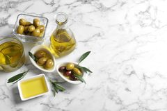 Composition with fresh olive oil. On marble background royalty free stock photo