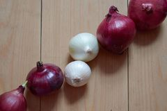 Composition with fresh onions on a wooden table royalty free stock photo