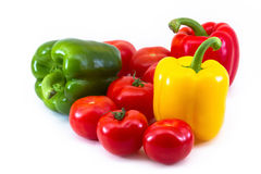 A composition of fresh paprikas and tomatoes Stock Photos