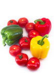 A composition of fresh paprikas and tomatoes Royalty Free Stock Image