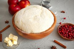 Composition with fresh raw dough. On table Stock Images