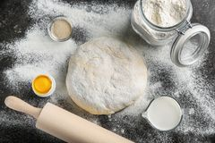 Composition with fresh raw dough. On table Royalty Free Stock Images