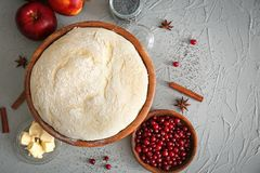 Composition with fresh raw dough. On table Stock Image