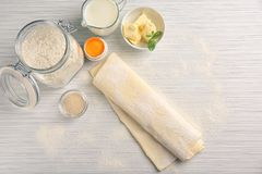Composition with fresh raw puff dough. On table Royalty Free Stock Image