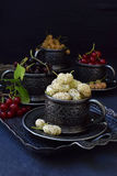 Composition of fresh ripe berries: red, black and white currant, mulberry on a dark gray concrete background. Dark photo. Photogra Stock Photography