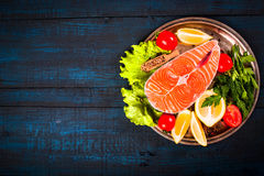 Composition with fresh salmon, herbs, parmesan and spices. Food background Stock Photography