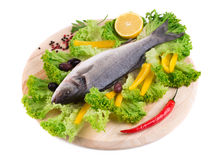 Composition of fresh seabass and vegetables. Stock Photos