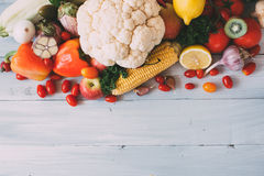 Composition of fresh vegetables on a wooden background. Royalty Free Stock Photo