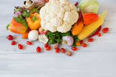Composition of fresh vegetables on a wooden. Stock Photos