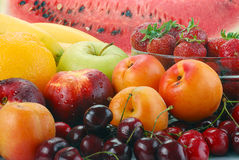 Composition with fruits. Including: apple, cherries, apricots, watermelon and strawberries Stock Images