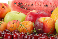Composition with fruits. Including: apple, cherries, apricots and watermelon Royalty Free Stock Photography