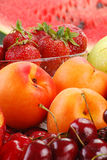 Composition with fruits. Including: apple, cherries, apricots and strawberries Stock Photo
