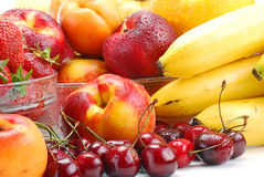Composition with fruits. With visible drops of water Stock Photos